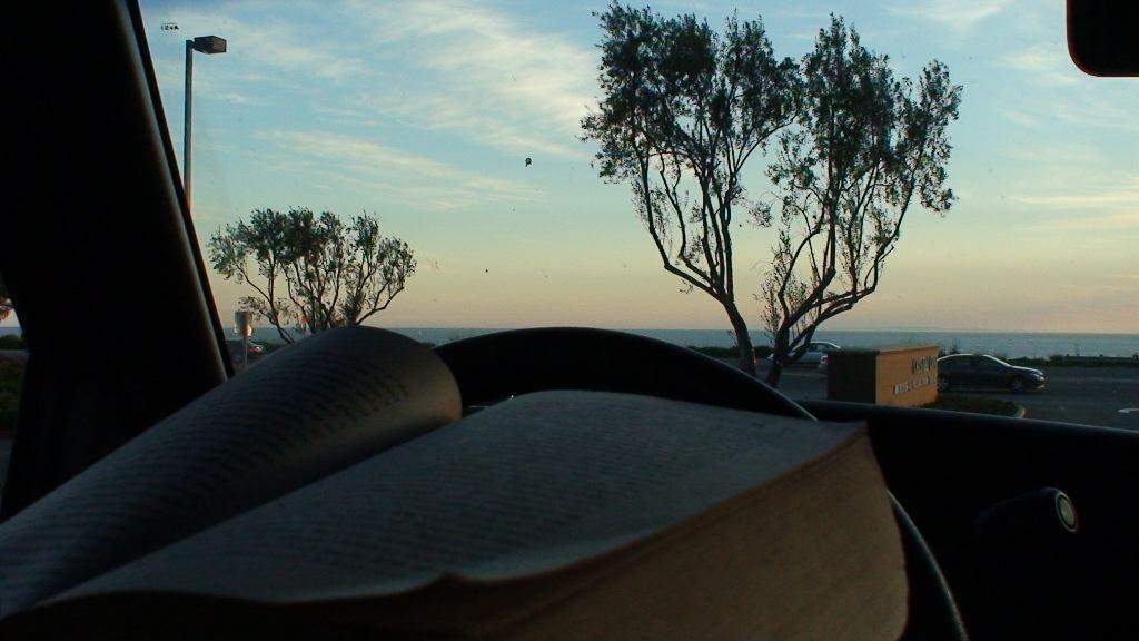 Reading in my truck @ home in Laguna Beach, California